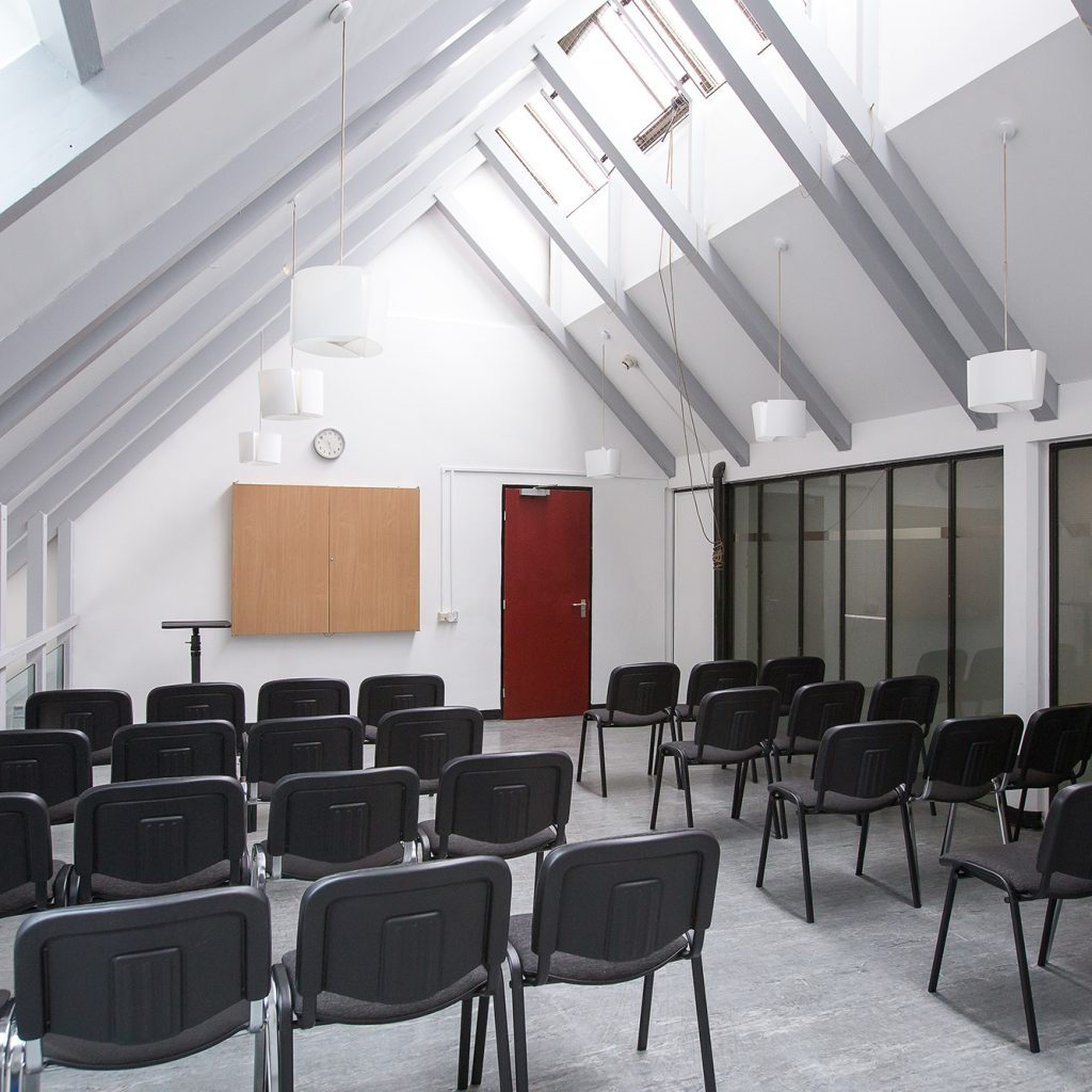 Meeting room with rowed seating