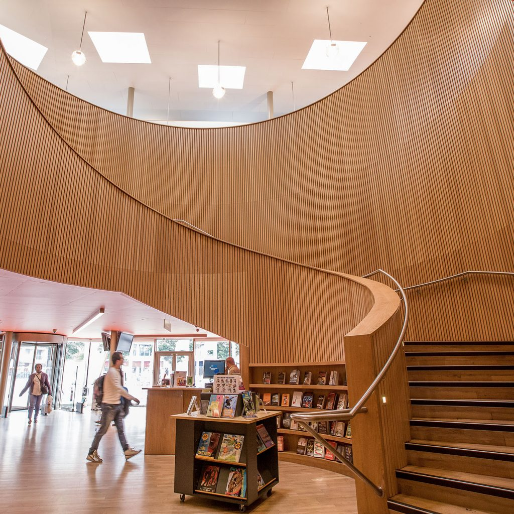 Light wood, open plan foyer and large spiral staircase in Canada Water library.