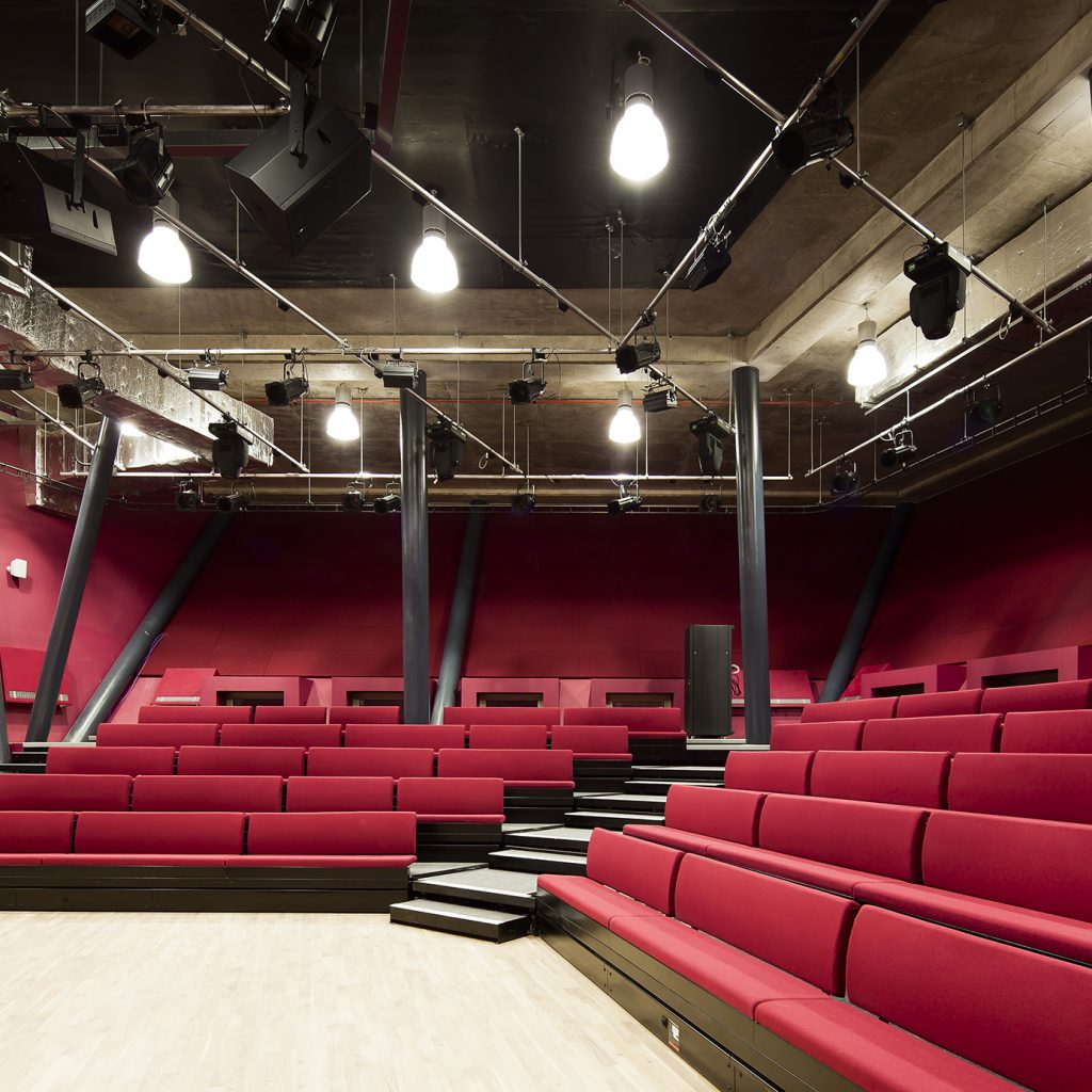 Theatre space with red bench seats