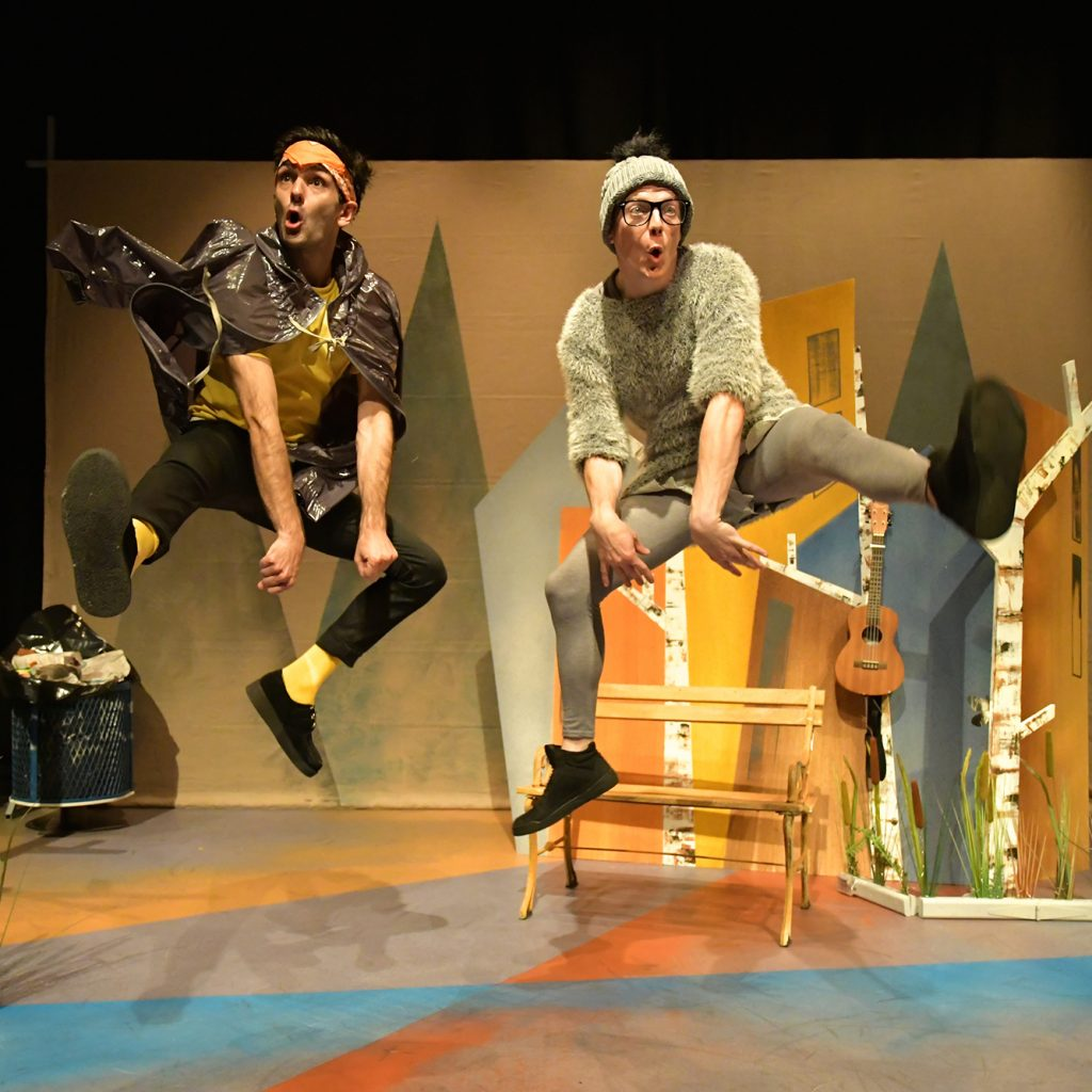 Image shows 2 male actors jumping in the air on the set of Ugly Duckling.