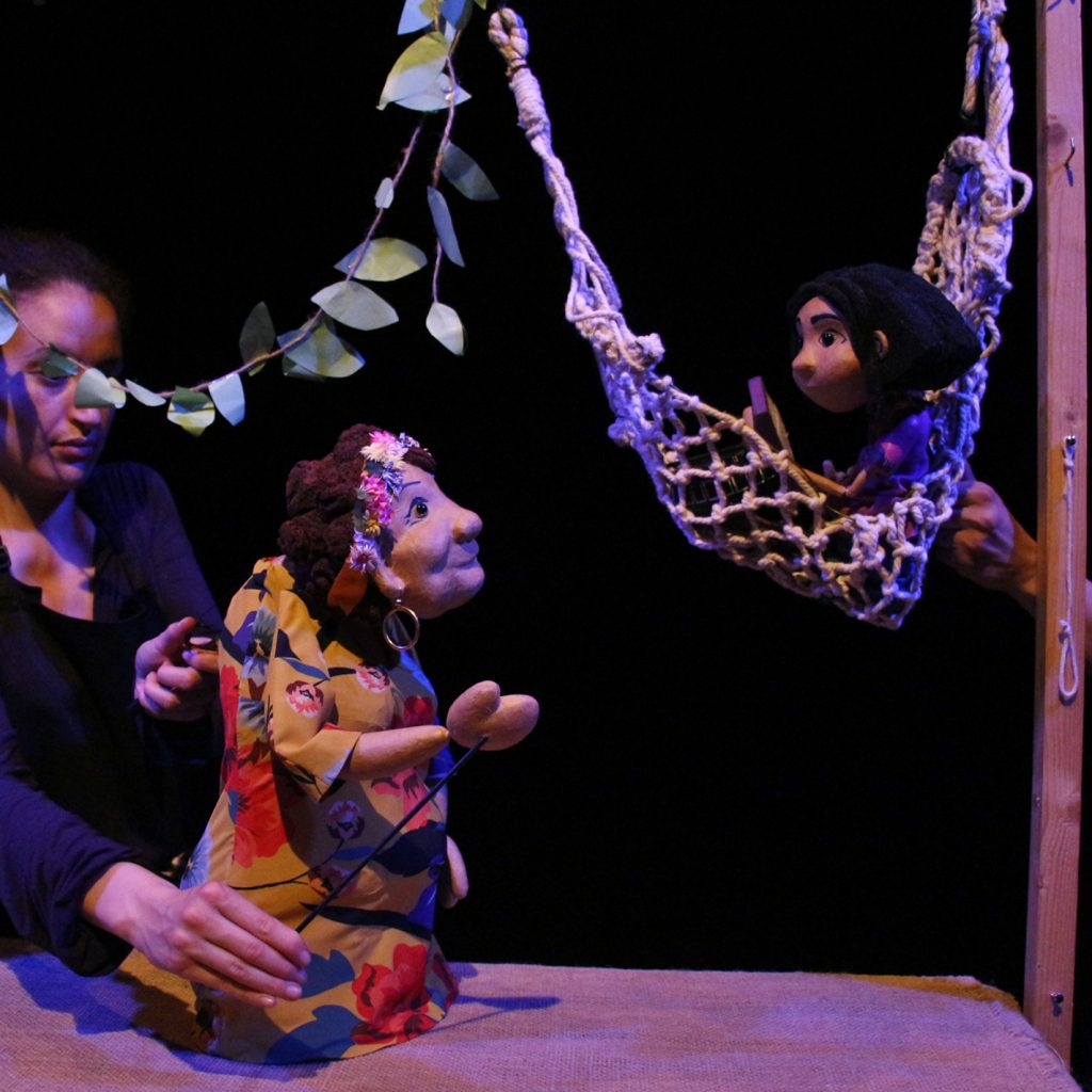 A production shot for Stories on a String featuring an old lady and a teenager puppet.