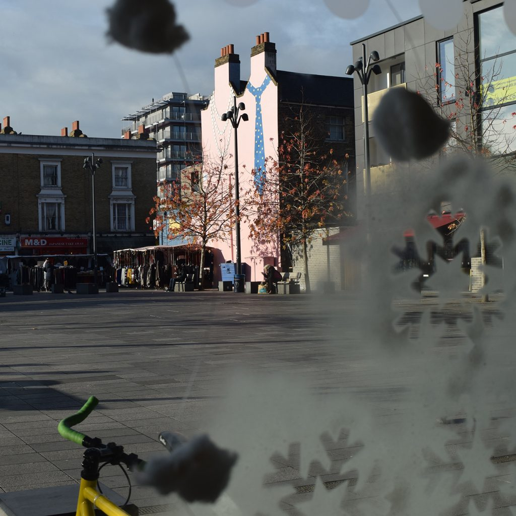 View from the front window of Deptford Lounge over Giffin Square with frost patterns.