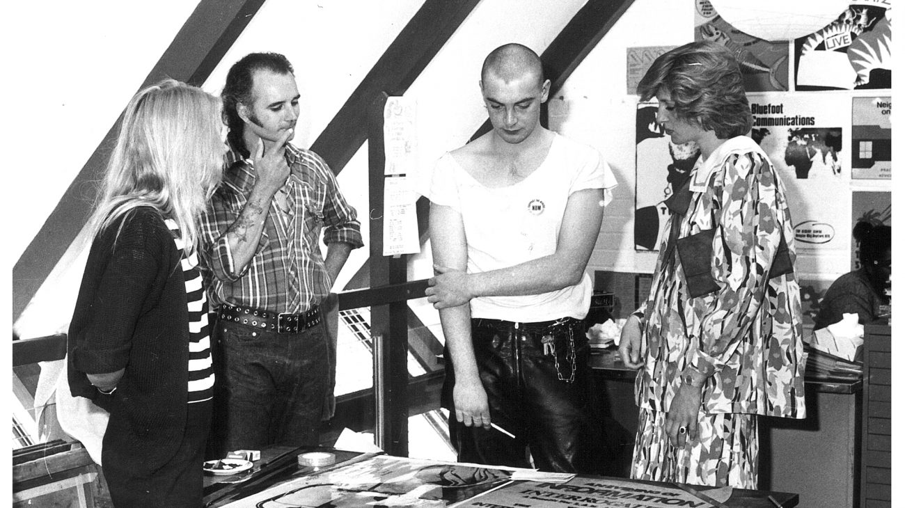 Princess Diana chatting with artists working at the Albany, in an artist's studio.
