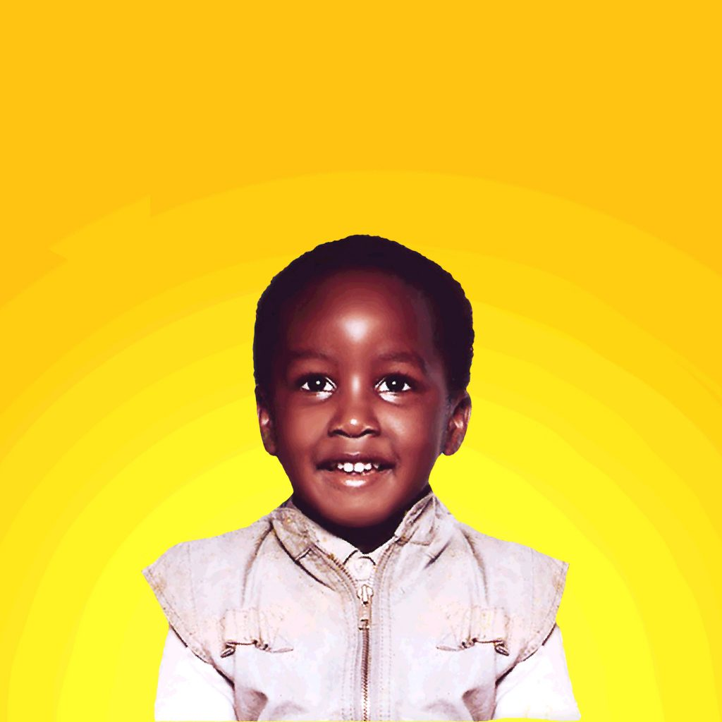 Photo of a small, sweet looking black child, wearing a beige zip top, with short hair, on a bright yellow background.