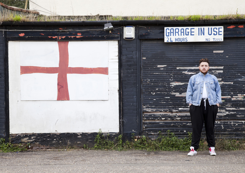 Scottee next to a St George's Flag