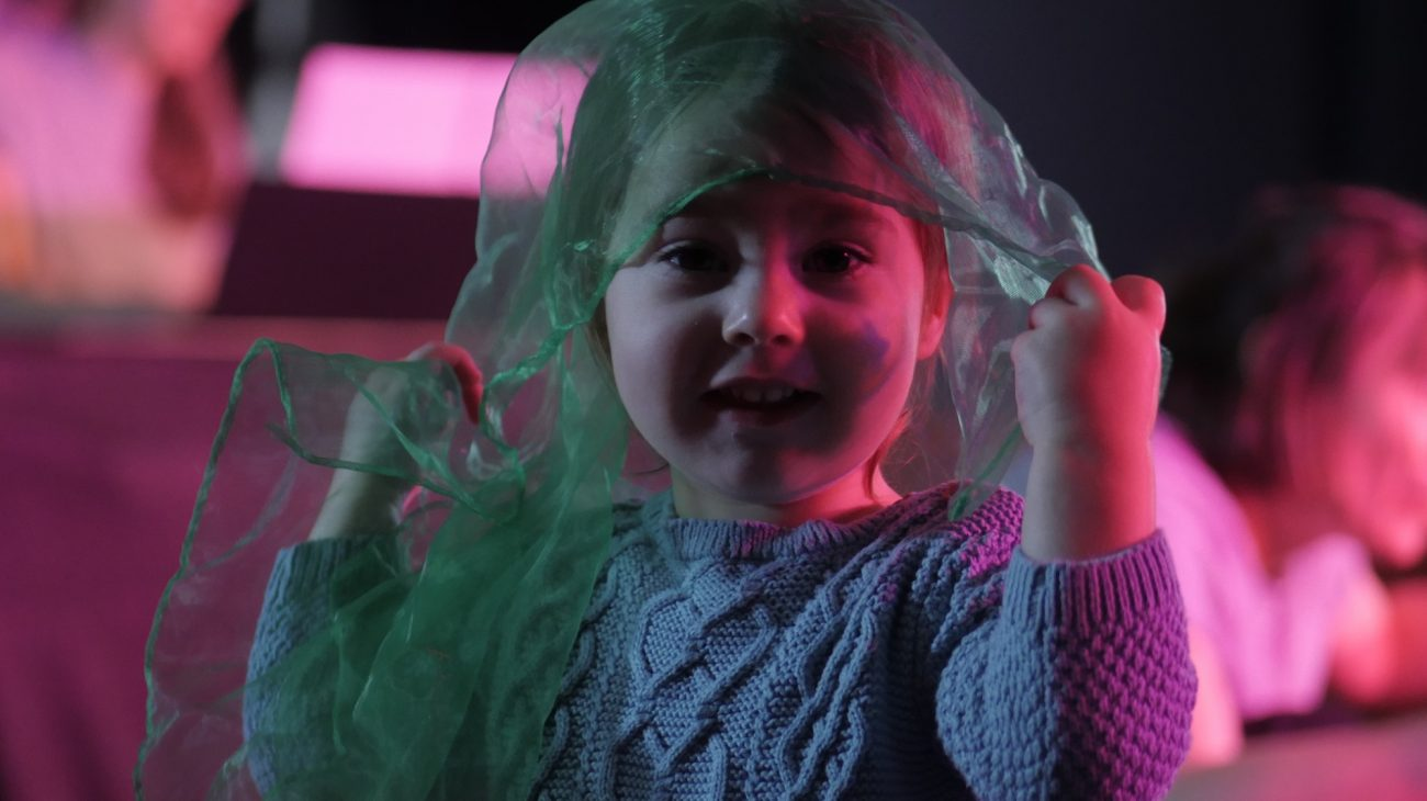 A young audience member enjoying Over The Moon.