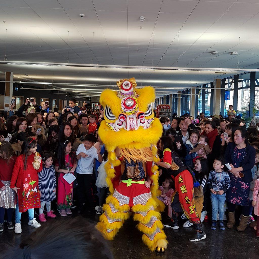 Big crowd around a huge Vietnamese dragon