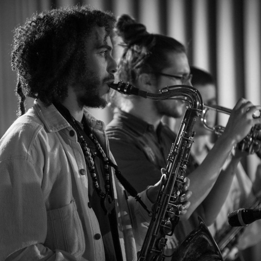 Image of three people playing saxophones