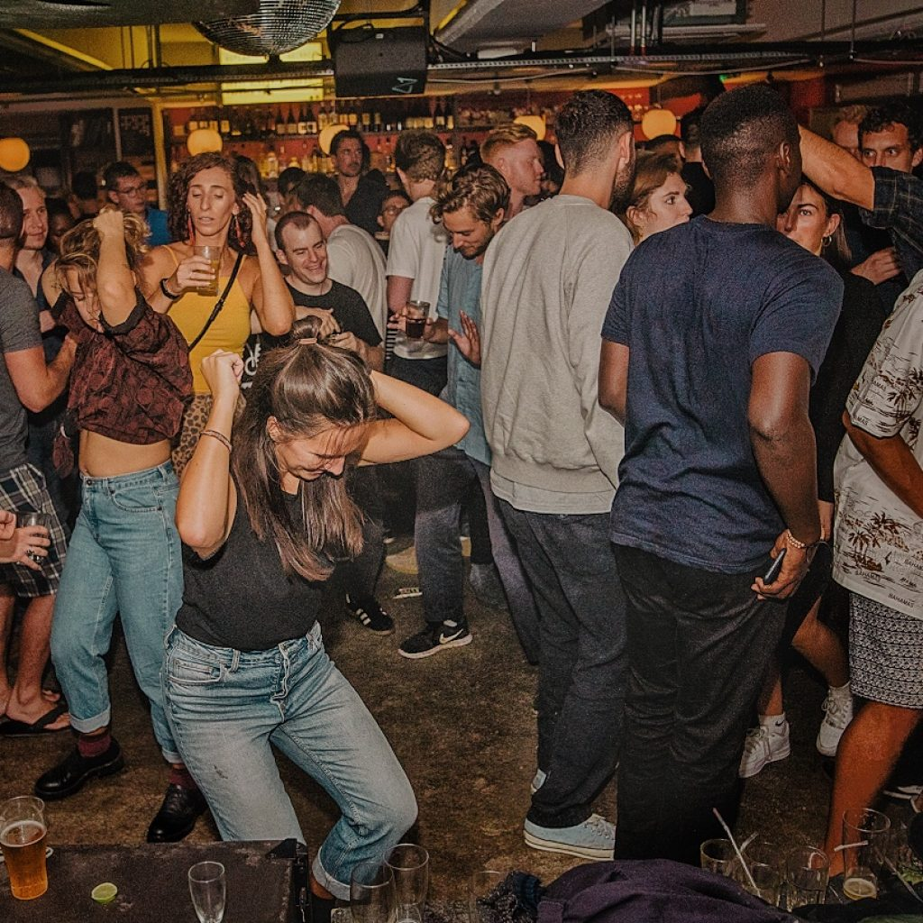 Image of a crowd of people dancing in a club.
