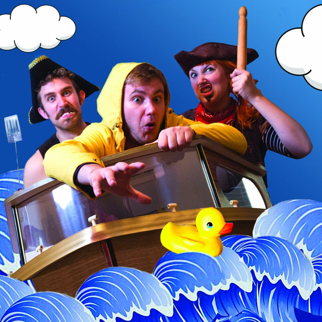 Three performers floating in a boat on a cartoon sea.