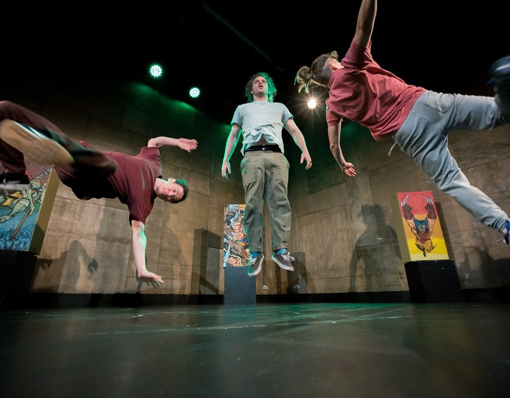 Image of three performers dancing in mid-air
