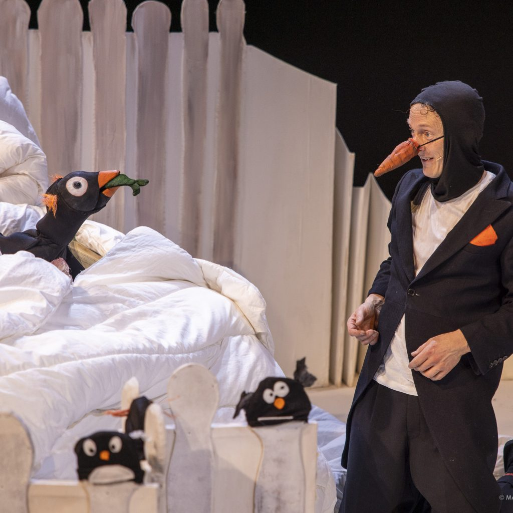 The inventor dressed up as a penguin with a big orange beak